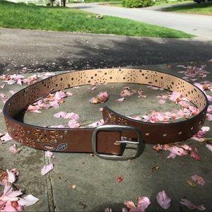 Floral cutout, studded brown belt